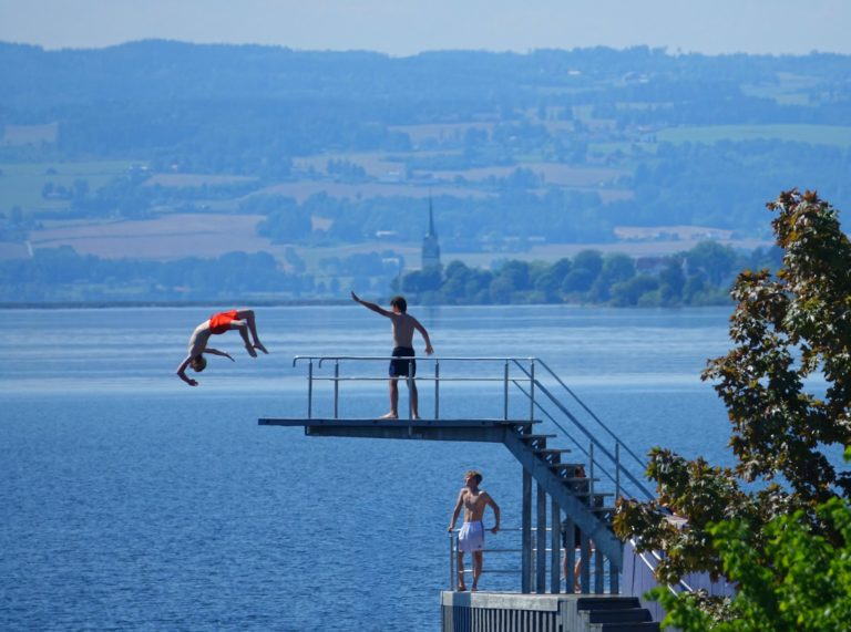 A couple of super heroes battling it out at the most expensive diving board in Norway, possibly the world. At least it's in better shape than the pier at that lake in the forest.