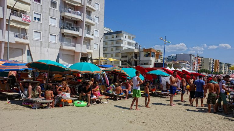 People suffering in the heat on the beach in Dürres, Albania.