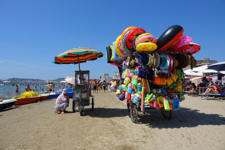 Plastic items for sale on the beach in Durrës, Albania.