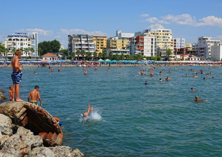People enjoying themselves on Golem beach, in Durrës, Albania.