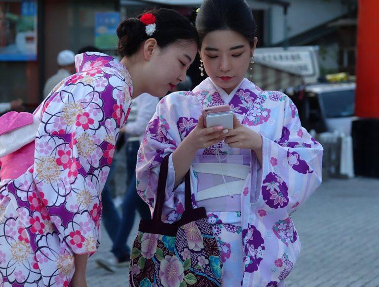 Geisha-for-day girls checking their photos.