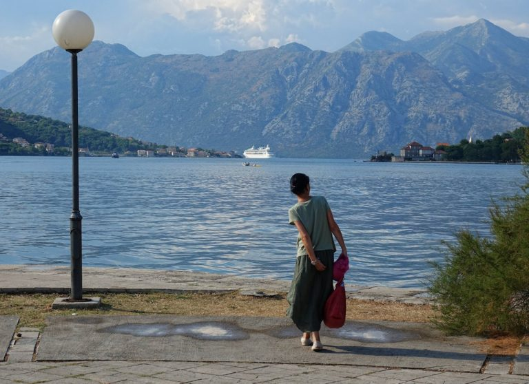 Cruise ship leaving Kotor Bay, and woman with an itch.