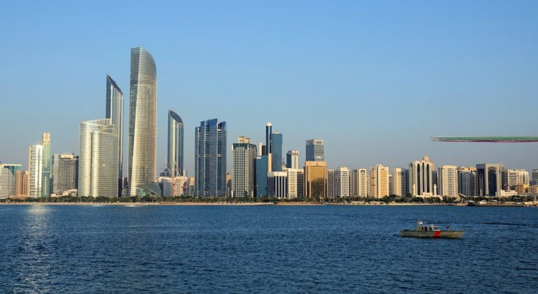 Al Fursan, the aerobatics team of the United Arab Emirates Air Force, flying above downtown Abu Dhabi.