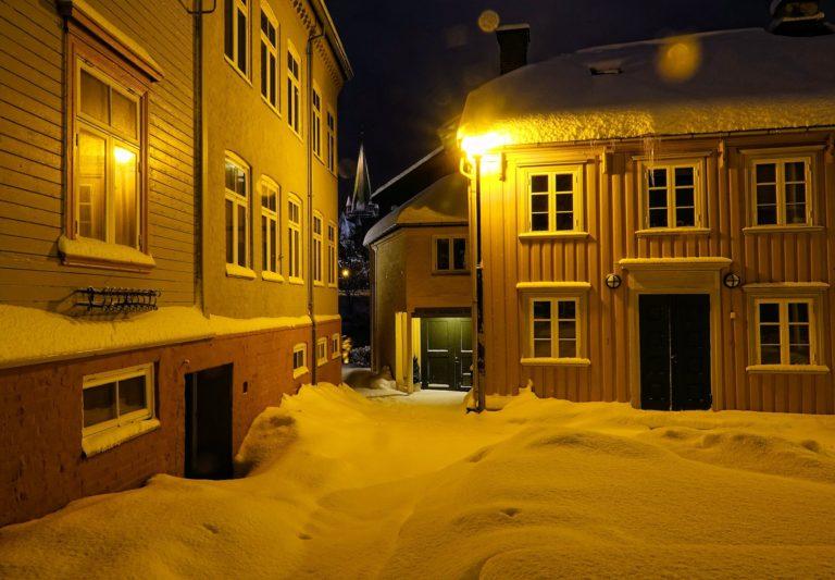 Nidaros Cathedral hiding between houses in Bakklandet.