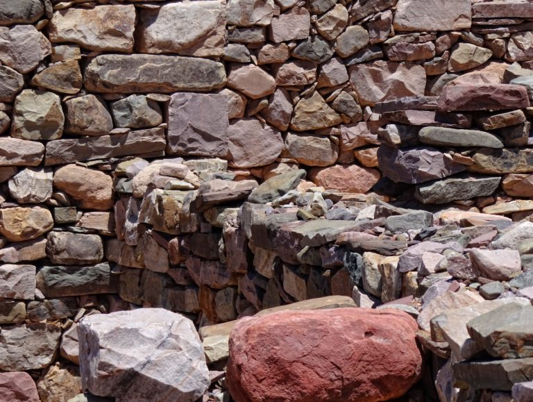 Colorful stones used to build fences and houses in the Pucará de Tilcara in Argentina.