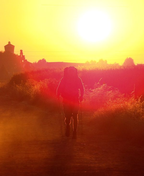 Pilgrim on Camino de Santiago walking early in the morning.