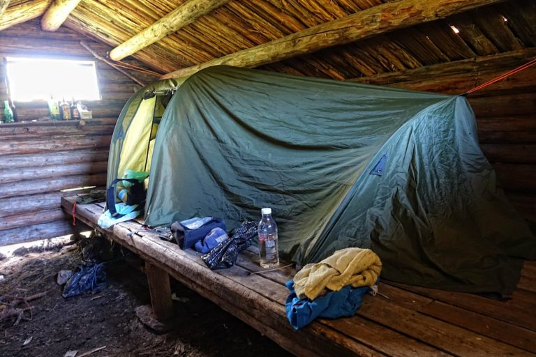 When the cabin is so shady that you pitch your tent inside it to stay safe.