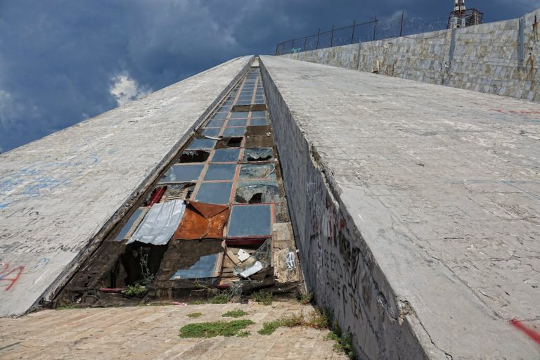 The climb up the facade of the Pyramid of Tirana isn't too steep.