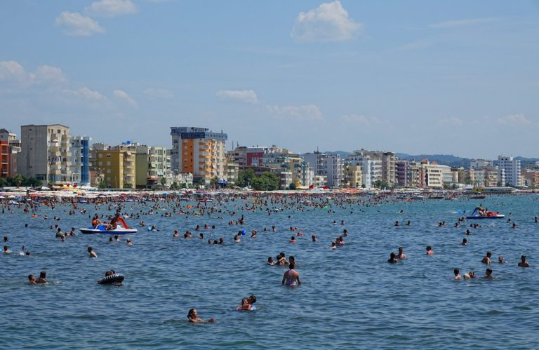Lots of people in the water on Golem beach, Durrës, Albania.