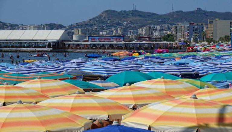 A roof of parasols on Golem beach in Durrës, Albania.