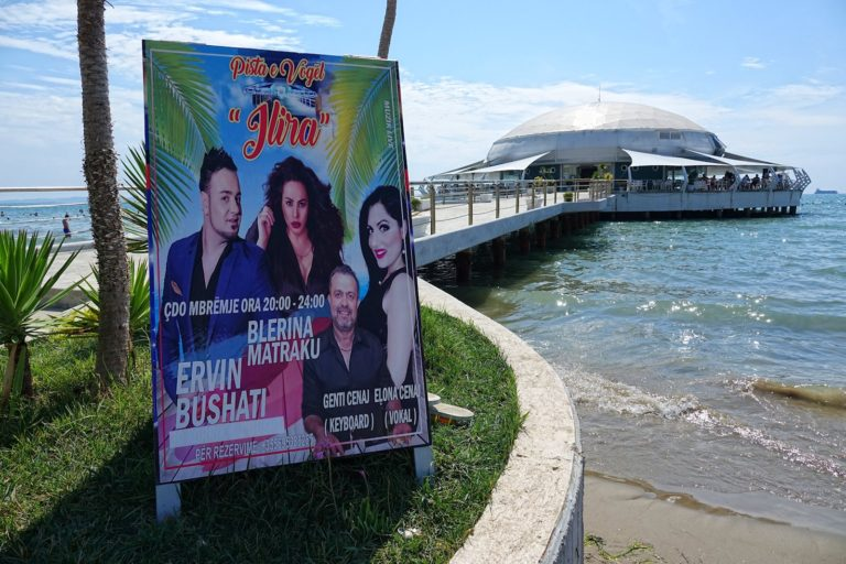 Blerina Matraku performance poster on a beach restaurant in Durrës, Albania.