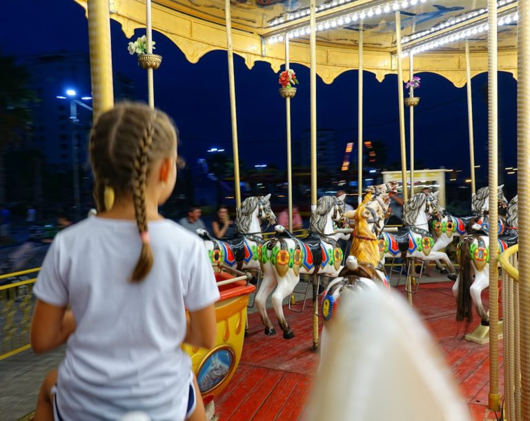 Riding a merry-go-round in Durrës, Albania.