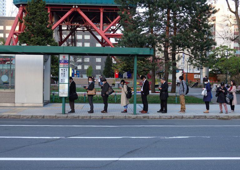 Japanese bus queue.