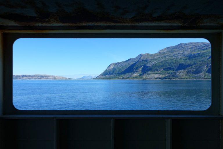 Coastline framed by ferry window.