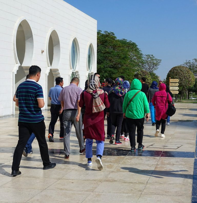 Chinese tourists demonstrating a minimum of effort when visiting a mosque in Abu Dhabi.