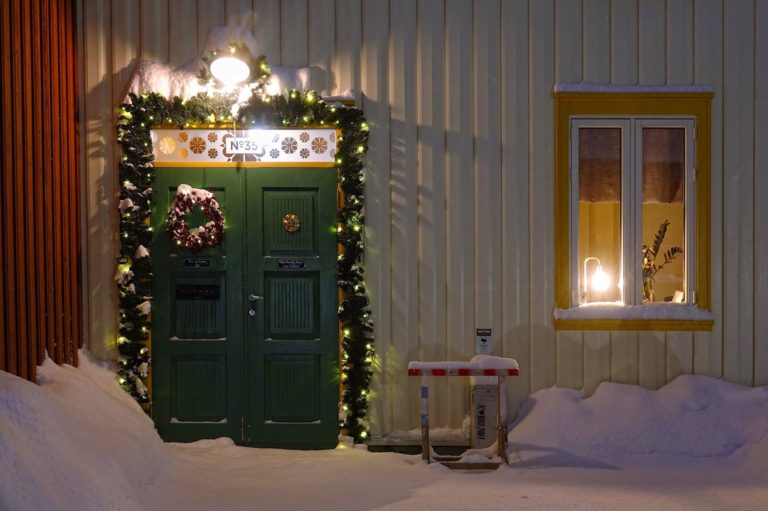 Christmas decorations on a door in Bakklandet, Trondheim, Norway.