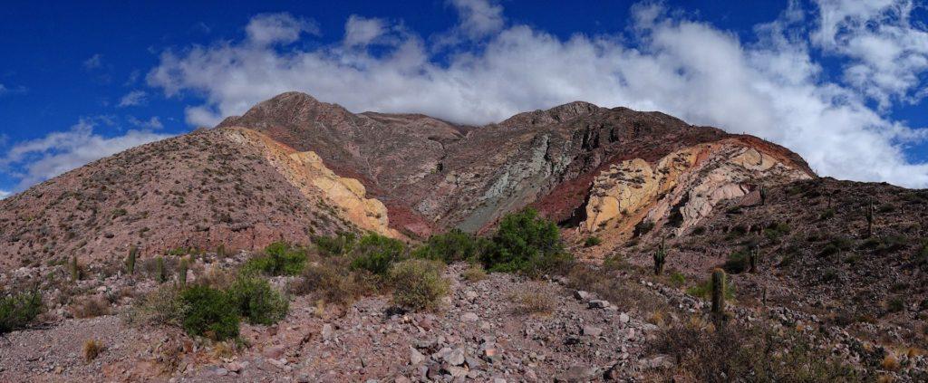 Panorama showing some of the colored rocks across the river from Maimares in Jujuy, Argentina.