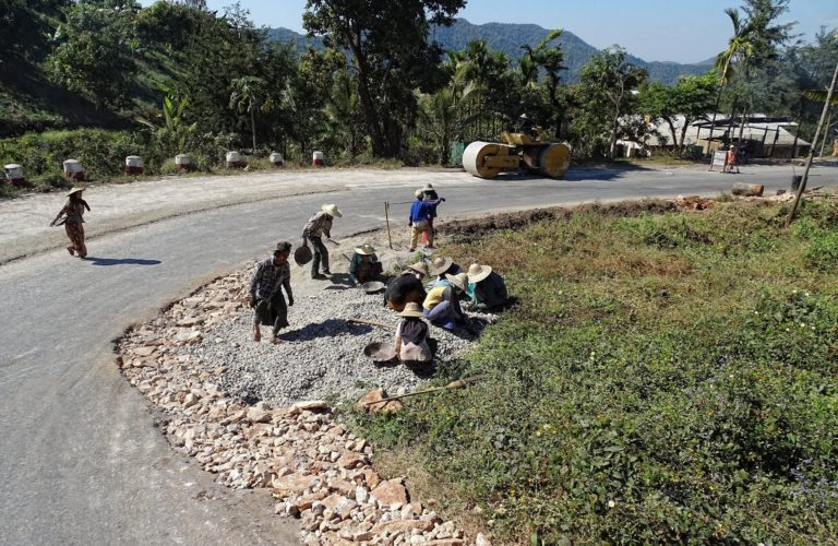 Building roads is hard work in Myanmar, thanks to the combination of hot sun and little equipment.