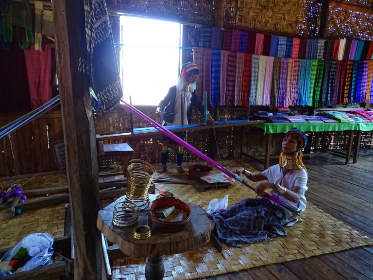 Photo of two long-neck women from Inle Lake, Myanmar.