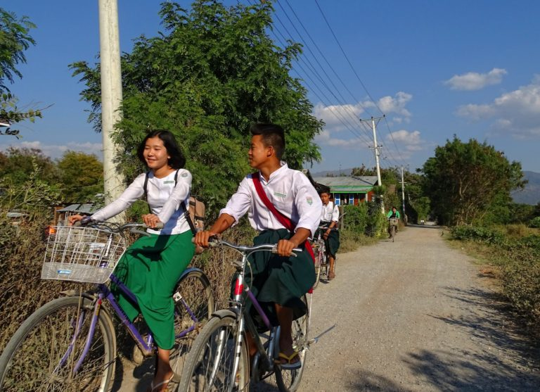 Students in Nyaung Shwe are happy to bike home from school.