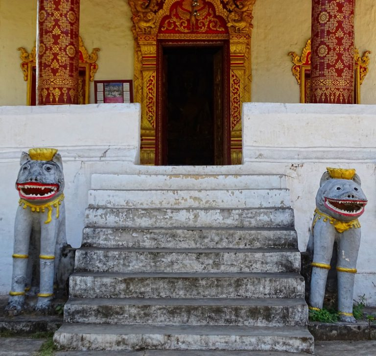 Not so scary lions protecting a temple in Luang Prabang