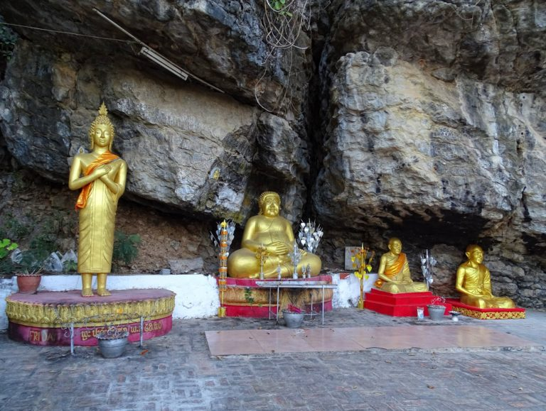 A group of four diverse Buddhas up on Mount Phousi in Luang Prabang, Laos