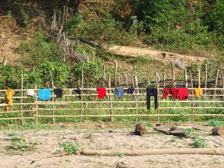 Signs of civilization; laundry on the banks of the Mekong River