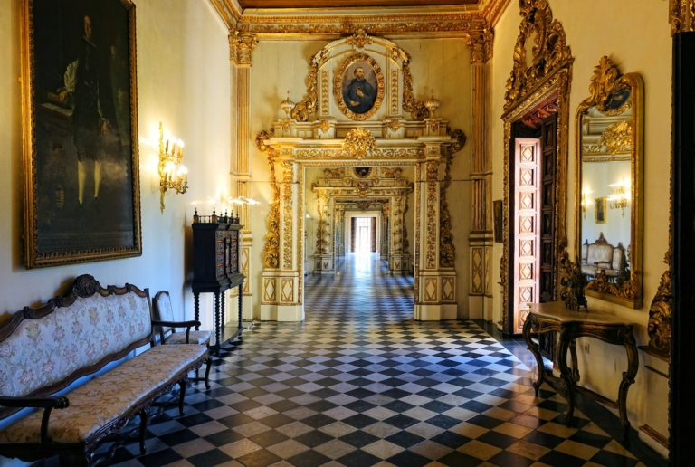 Long golden hall in the Gandia Palace.