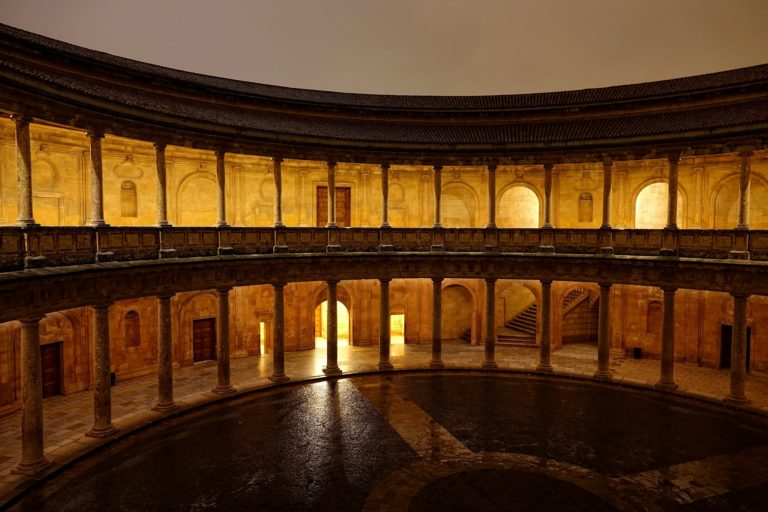 Carlos V Palace Courtyard in Alhambra, by night.
