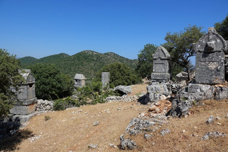 Photo of Lycian tombs at the top of Apollonia, Turkey.