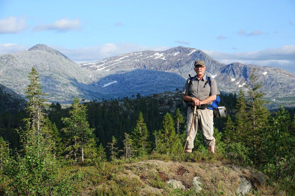 Roald Tørrissen standing in front of Breivasstind, Brønnøy, Norway.