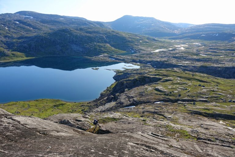 Hiker made to feel like an ant in Lomsdal-Visten National Park, Norway.