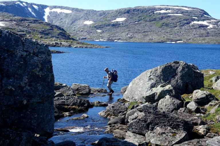Crossing a small stream in Lomsdal-Visten National Park, Norway.