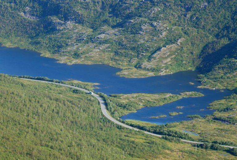 Bus passing on Tosenveien in Nordland, Norway.