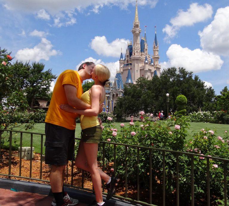 Photo of couple kissing at Walt Disney World in Orlando, Florida.