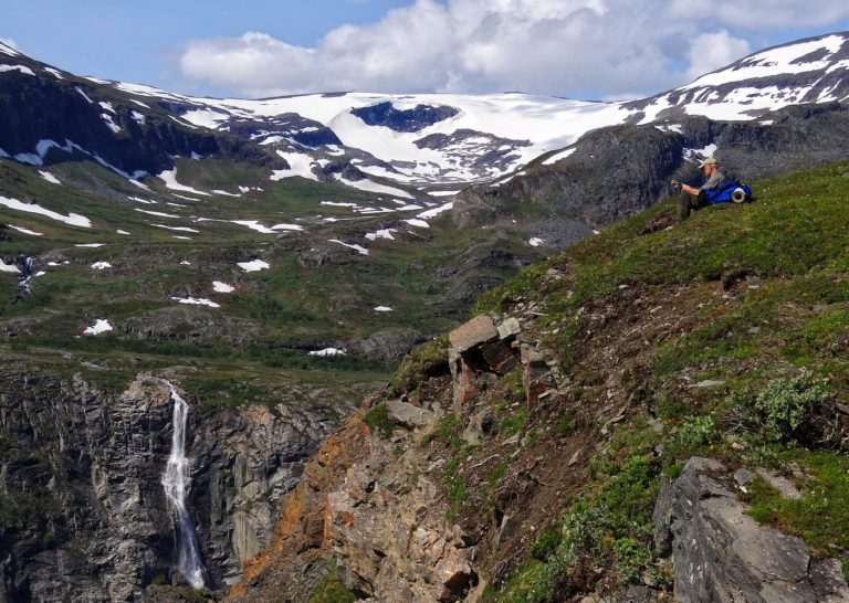 Photo of man looking at map in Rohkunborri National Park in Northern, Norway.