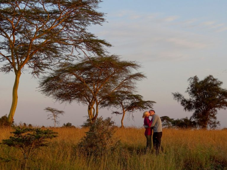 Photo of couple kissing on the Swara Plains near Nairobi, Kenya.