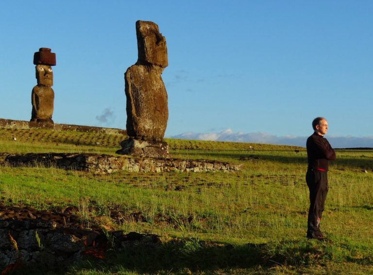 Photo of guys facing the sunrise on Easter Island, Chile.