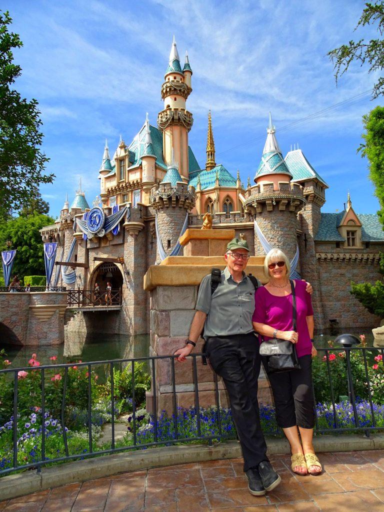 Photo of happy older couple in Disneyland, California.