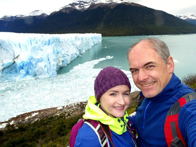 Photo of couple posing in front of Perito Moreno glacier, Argentina