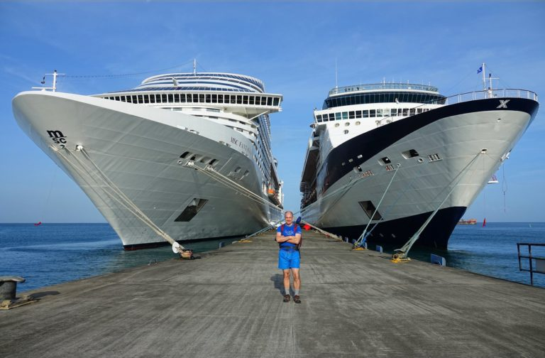 Photo of man who has just parked his cruise ship and is ready to go exploring.