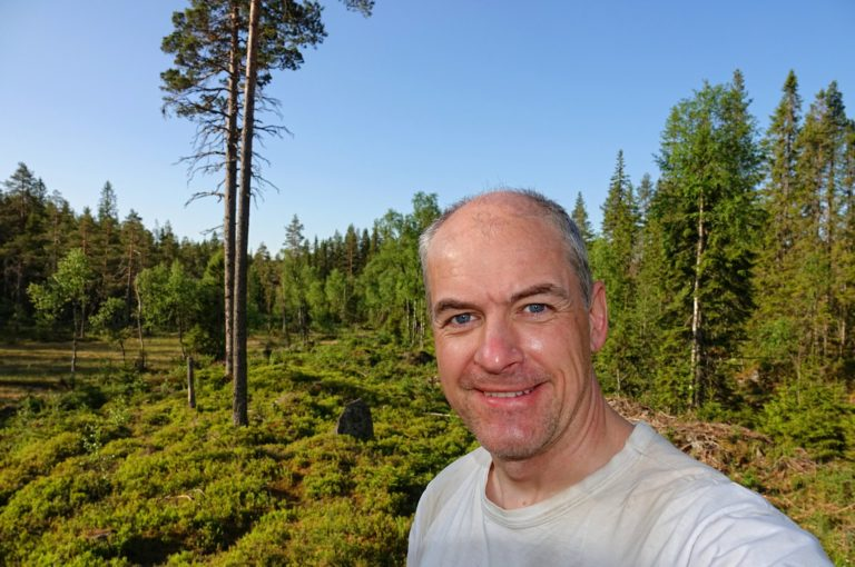 Photo of man hiking Rondanestien long-distance trail in Norway.