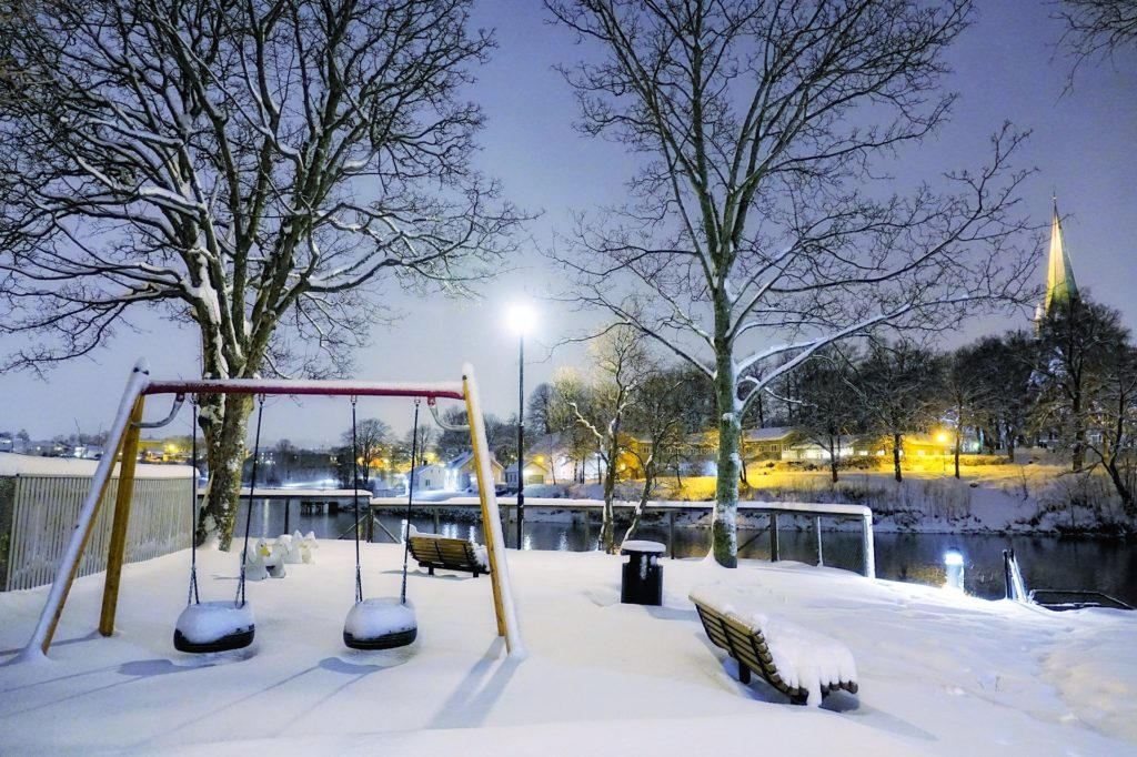 Photo of a playground covered in snow in Trondheim, Norway.
