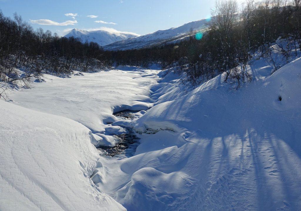 Photo of frozen river in Salangsdalen valley, Troms, Norway