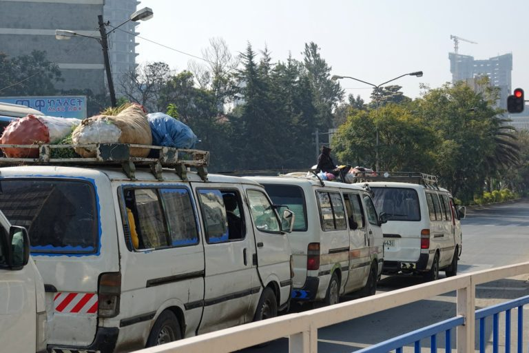 Photo of rooftop rider in Addis Ababa, Ethiopia