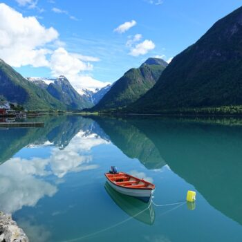 Photo of small boat in Fjærlandsfjorden, Norway.
