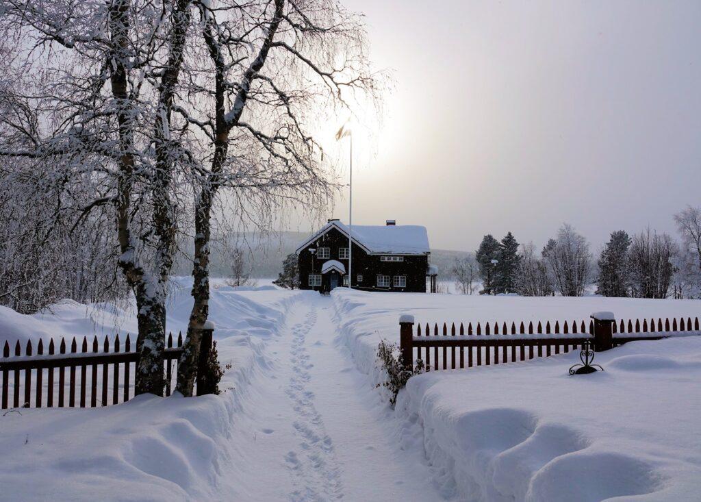 Photo of house in the Arctic, Jukkasjärvi, Sweden.