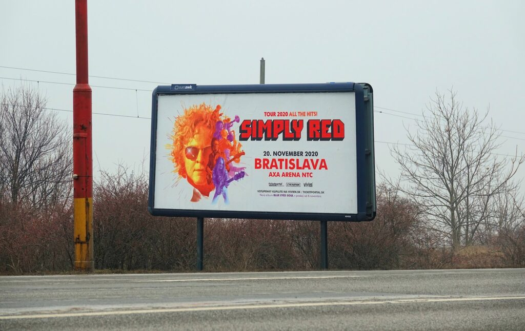 Photo of Simply Red poster next to the highway outside Bratislava, Slovakia.