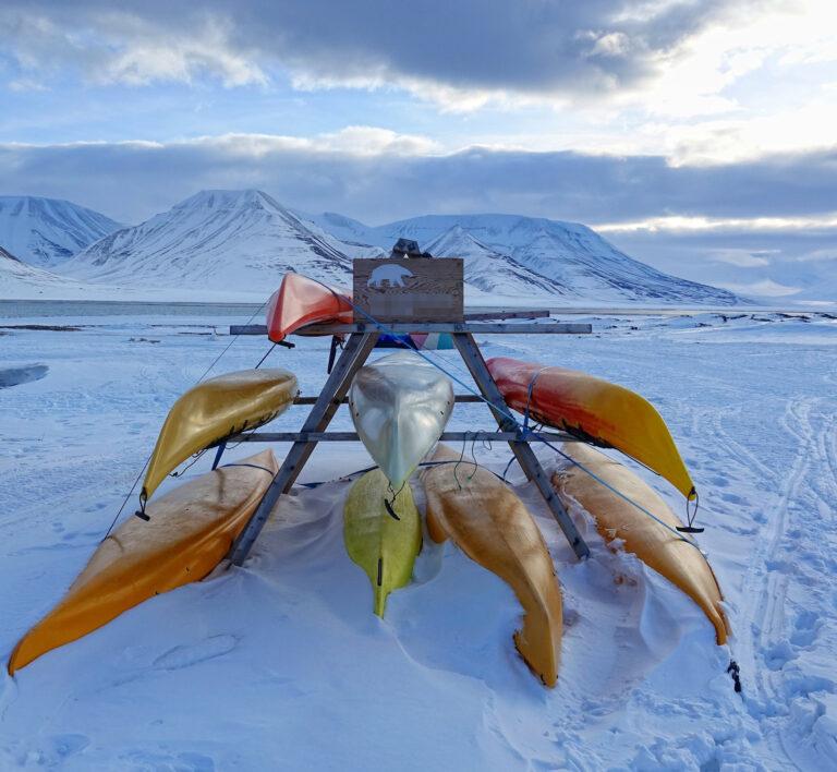 Photo of rental kayaks in Longyearbyen, Norway, during winter.