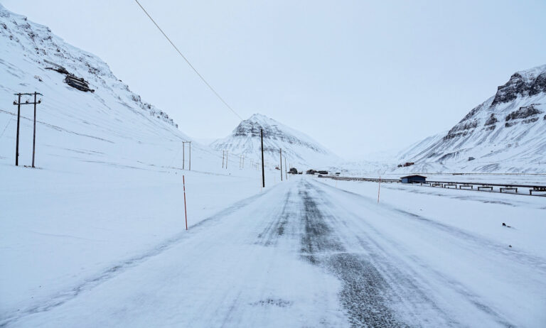 Photo of the road between the town center and Nybyen in Longyearbyen, Svalbard.